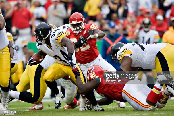Running back Rashard Mendenhall of the Pittsburgh Steelers is tackled by the shirt by defensive end Glenn Dorsey of the Kansas City Chiefs at...