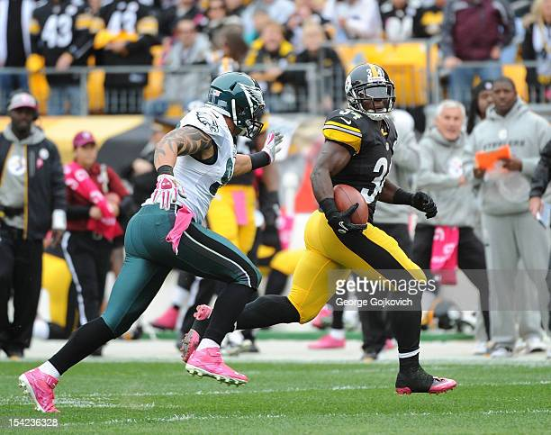 Running back Rashard Mendenhall of the Pittsburgh Steelers runs from defensive end Jason Babin of the Philadelphia Eagles during a game at Heinz...