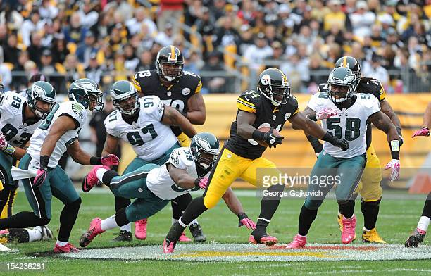 Running back Rashard Mendenhall of the Pittsburgh Steelers runs against defensive linemen Jason Babin Cullen Jenkins and Trent Cole linebacker DeMeco...