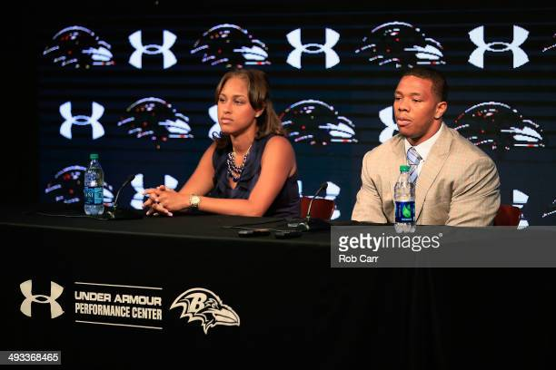 Running back Ray Rice of the Baltimore Ravens addresses a news conference with his wife Janay at the Ravens training center on May 23, 2014 in Owings...