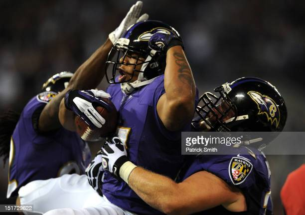 Running back Ray Rice of the Baltimore Ravens celebrates his seven-yard touchdown run against the Cincinnati Bengals in the first half at M&T Bank...