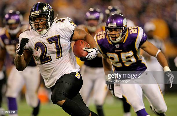 Running back Ray Rice of the Baltimore Ravens eludes Tyrell Johnson of the Minnesota Vikings as he rushes 33 yards for a fourth quarter touchdown...