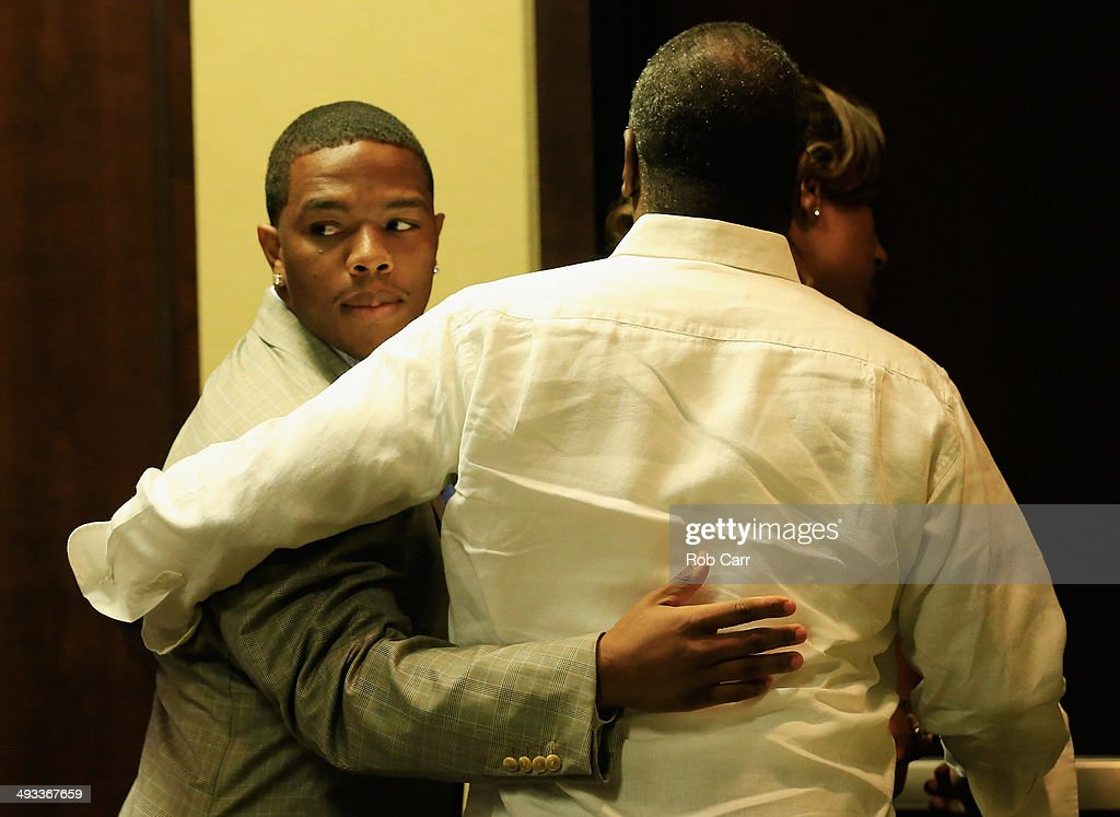 Running back Ray Rice of the Baltimore Ravens gets a hug from his wife Janay and father in law Joe Palmer following a news conference at the Ravens training center on May 23, 2014 in Owings Mills, Maryland. Rice spoke publicly for the first time since facing felony assault charges stemming from a February incident involving Janay at an Atlantic City casino.