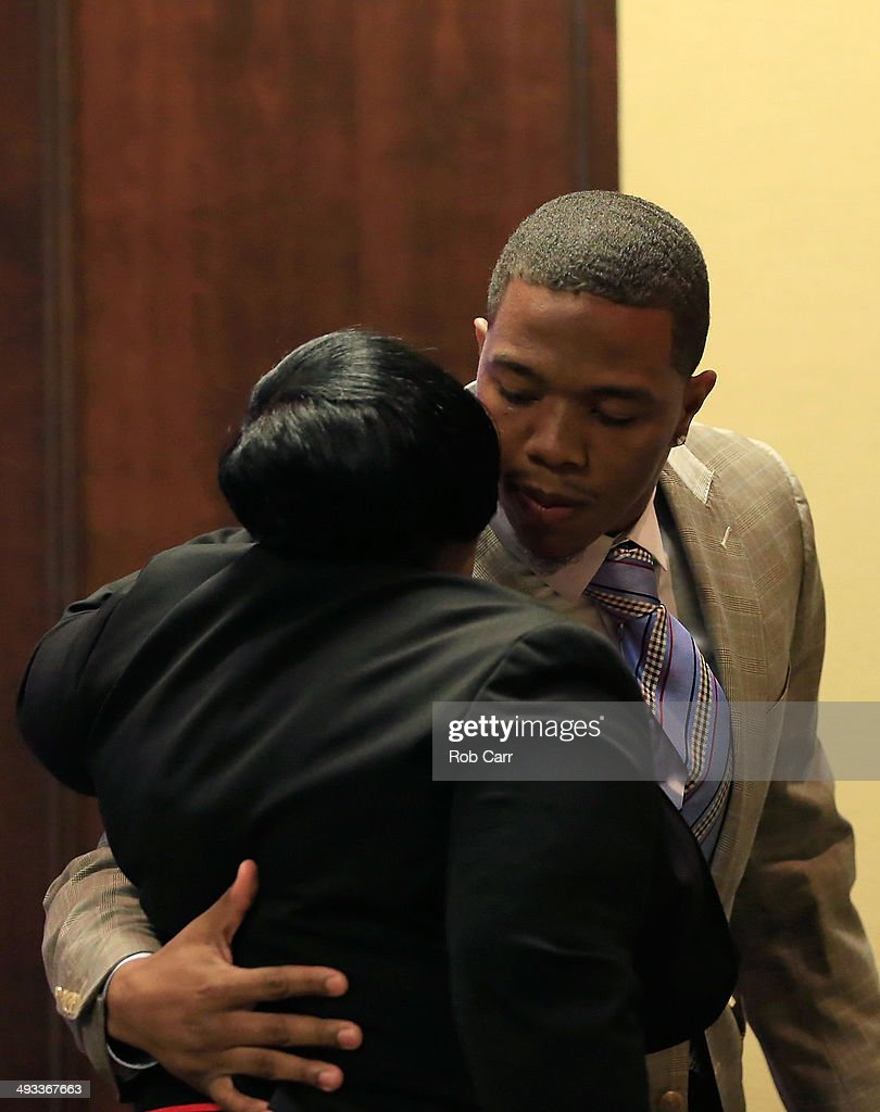 Running back Ray Rice of the Baltimore Ravens hugs his motherJanet Rice after addressing a news conference with his wife Janay (not pictured) at the Ravens training center on May 23, 2014 in Owings Mills, Maryland. Rice spoke publicly for the first time since facing felony assault charges stemming from a February incident involving Janay at an Atlantic City casino.