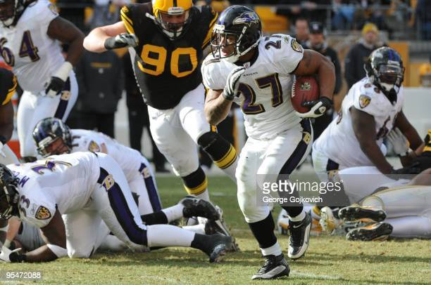Running back Ray Rice of the Baltimore Ravens is pursued by defensive lineman Travis Kirschke of the Pittsburgh Steelers during a game at Heinz Field...