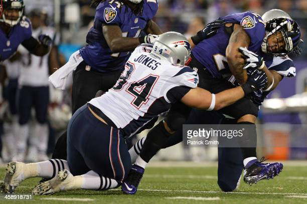 Running back Ray Rice of the Baltimore Ravens is tackled by defensive tackle Chris Jones of the New England Patriots in third quarter at MT Bank...