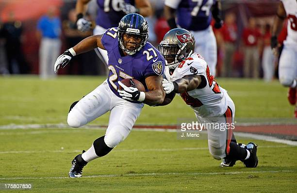 Running back Ray Rice of the Baltimore Ravens is tackled by linebacker Lavonte David of the Tampa Bay Buccaneers during a preseason game at Raymond...