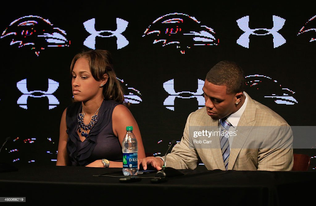 Running back Ray Rice of the Baltimore Ravens looks over his notes while addressing a news conference with his wife Janay at the Ravens training center on May 23, 2014 in Owings Mills, Maryland. Rice spoke publicly for the first time since facing felony assault charges stemming from a February incident involving Janay at an Atlantic City casino.