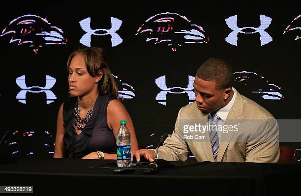 Running back Ray Rice of the Baltimore Ravens looks over his notes while addressing a news conference with his wife Janay at the Ravens training...