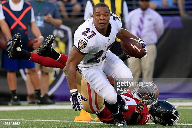 Running back Ray Rice of the Baltimore Ravens looses his helmet after being tackled by strong safety Antoine Bethea of the San Francisco 49ers during...