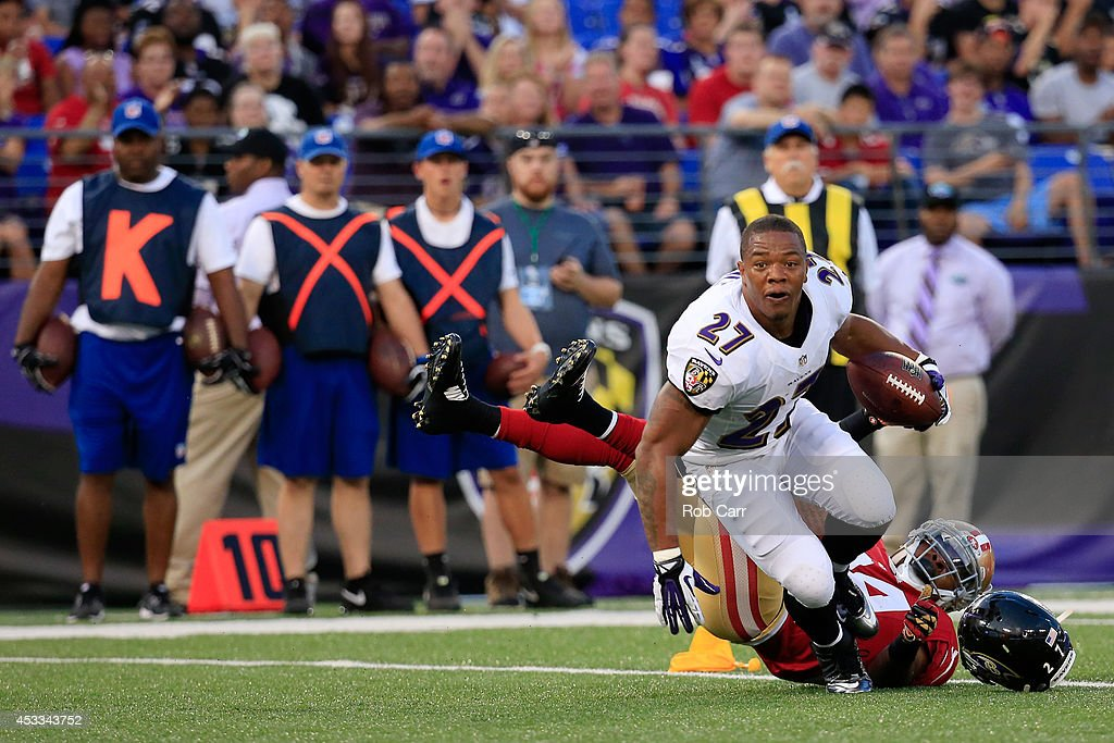 Running back Ray Rice #27 of the Baltimore Ravens looses his helmet after being tackled by strong safety Antoine Bethea #24 of the San Francisco 49ers during the first half of an NFL pre-season game at M&T Bank Stadium on August 7, 2014 in Baltimore, Maryland.