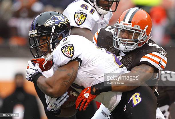 Running back Ray Rice of the Baltimore Ravens runs by defensive back T.J. Ward of the Cleveland Browns at Cleveland Browns Stadium on December 26,...