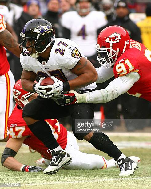 Running back Ray Rice of the Baltimore Ravens runs is tackled by Tamba Hali of the Kansas City Chiefs in a 2011 AFC wild card playoff game at...
