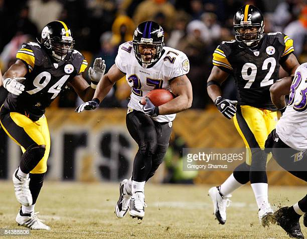 Running back Ray Rice of the Baltimore Ravens runs the ball against linebacker linebackers Lawrence Timmons and James Harrison of the Pittsburgh...