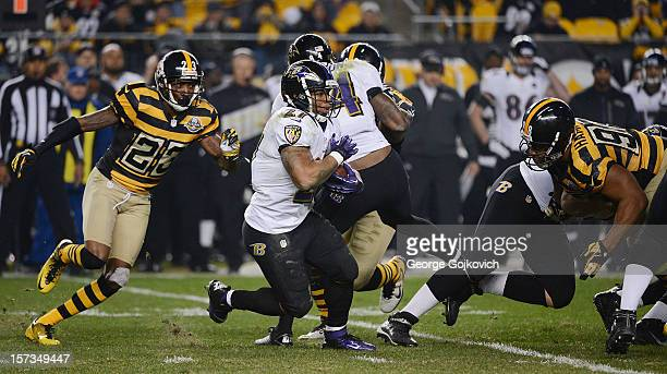 Running back Ray Rice of the Baltimore Ravens runs the football against cornerback Keenan Lewis and defensive lineman Casey Hampton of the Pittsburgh...
