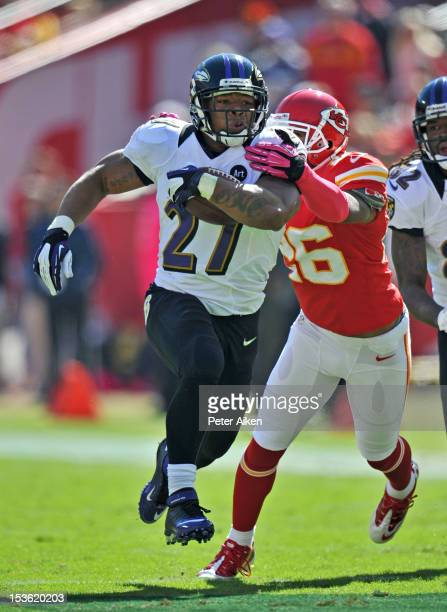 Running back Ray Rice of the Baltimore Ravens rushes up field past defensive back Stanford Routt of the Kansas City Chiefs during the first quarter...