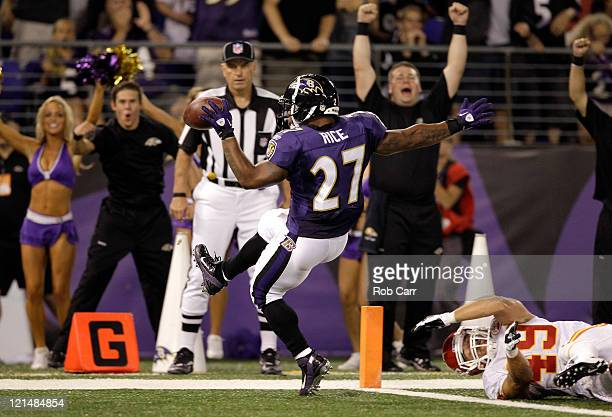Running back Ray Rice of the Baltimore Ravens scores a touchdown in front of safety Sabby Piscitelli of the Kansas City Chiefs during the first half...