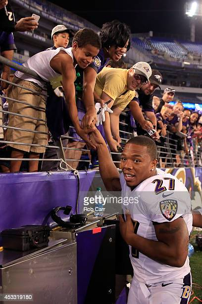 Running back Ray Rice of the Baltimore Ravens shakes hands with fans following the Ravens 23-3 win over the San Francisco 49ers during NFL pre-season...