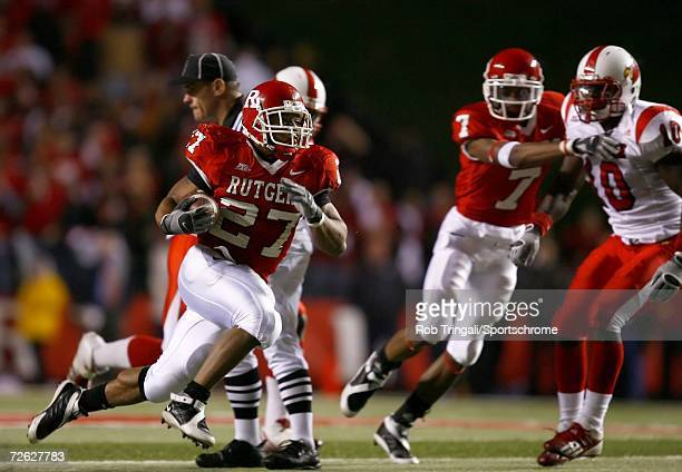 Running Back Ray Rice of the Rutgers Scarlet Knights runs with the ball against the Louisville Cardinals at Rutgers Stadium on November 9, 2006 in...