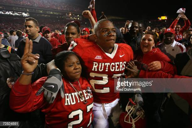 Running back Ray Rice of the Rutgers University Scarlet Knights celebrates after game on the field with his mom against the University of Louisville...