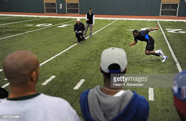 CSU running back Raymond Carter runs in the shuttle drill during the work out as scouts players and friends look on Scouts from 9 NFL teams turned...