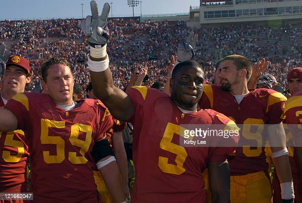 USC running back Reggie Bush and linebacker Collin Ashton celebrate 2317 victory over Cal in Pac10 Conference football game at the Los Angeles...