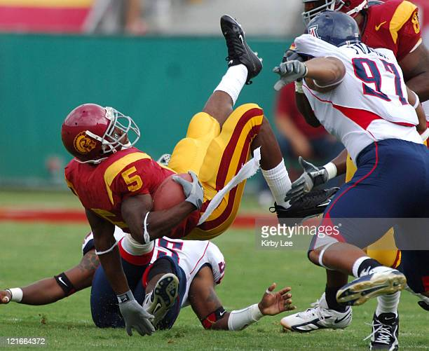 USC running back Reggie Bush is upended during 4221 victory over Arizona in Pacific10 Conference football game at the Los Angeles Memorial Coliseum...
