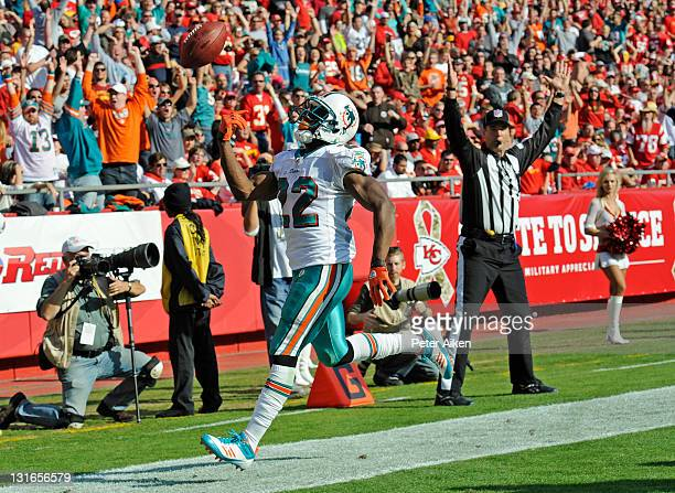 Running back Reggie Bush of the Miami Dolphins tosses the ball into the air after scoring a touch down against of the Kansas City Chiefs during the...