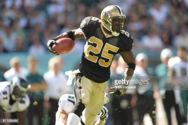 Running back Reggie Bush of the New Orleans Saints runs the ball during the game against the Philadelphia Eagles on September 20, 2009 at Lincoln...