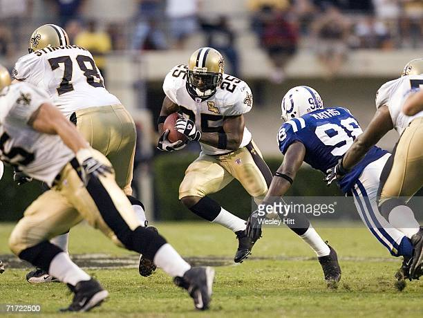 Running back Reggie Bush of the New Orleans Saints runs through the line against the Indianapolis Colts August 26 2006 at Mississippi Memorial...