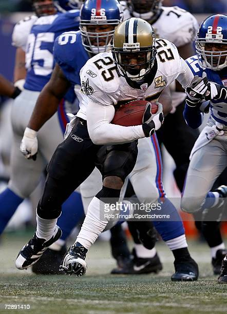 Running Back Reggie Bush of the New Orleans Saints runs with the ball against the New York Giants on December 24, 2006 at Giants Stadium in East...