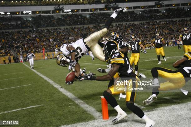 Running back Reggie Bush of the New Orleans Saints scores on a 15yard touchdown run against defensive backs Tyrone Carter and Bryant McFadden of the...
