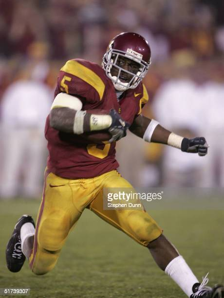 Running back Reggie Bush of the USC Trojans caries the ball against the Arizona Wildcats on November 13 2004 at the Los Angeles Coliseum in Los...