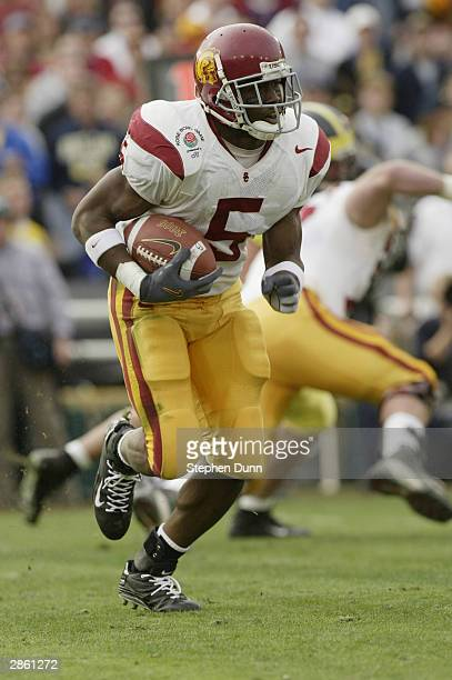 Running back Reggie Bush of the USC Trojans carries the ball during the 2004 Rose Bowl game against the Michigan Wolverines on January 1 2004 at the...
