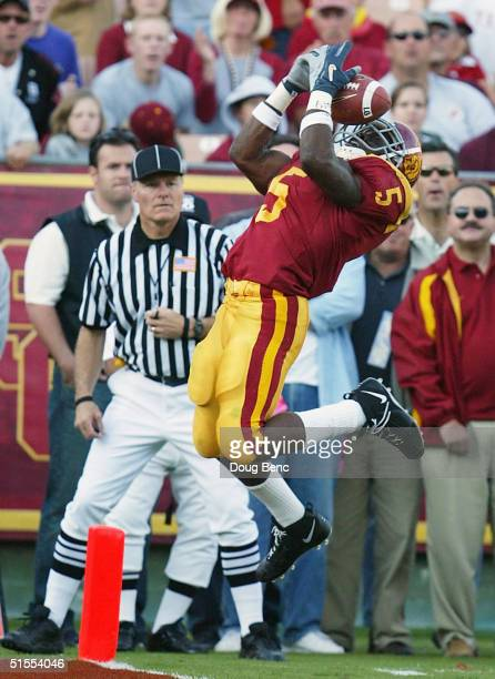 Running back Reggie Bush of the USC Trojans catches a touchdown pass in the second quarter against the Washington Huskies at the Los Angeles Coliseum...
