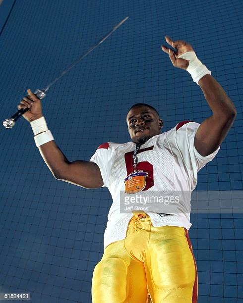 Running back Reggie Bush of the USC Trojans celebrates the team's 29-24 victory over the UCLA Bruins on December 4, 2004 at the Rose Bowl in...