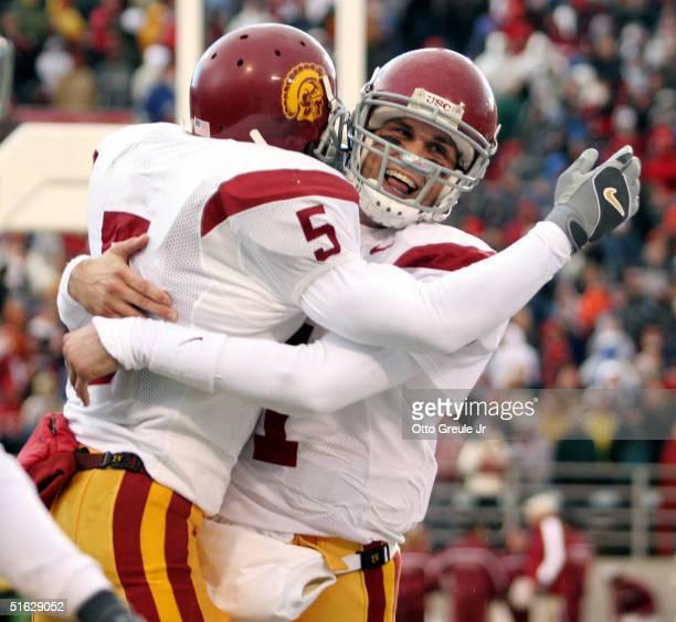 Running back Reggie Bush of the USC Trojans celebrates with quarterback Matt Leinart after scoring a touchdown against the Washington State Cougars...