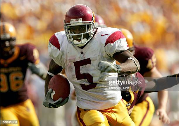 Running back Reggie Bush of the USC Trojans runs for a touchdown in the third quarter agains the Arizona State Sun Devils on October 1 2005 at Sun...