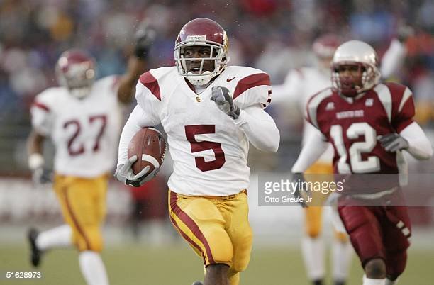 Running back Reggie Bush of the USC Trojans scores a touchdown on a punt return against the Washington State Cougars on October 30 2004 at Martin...
