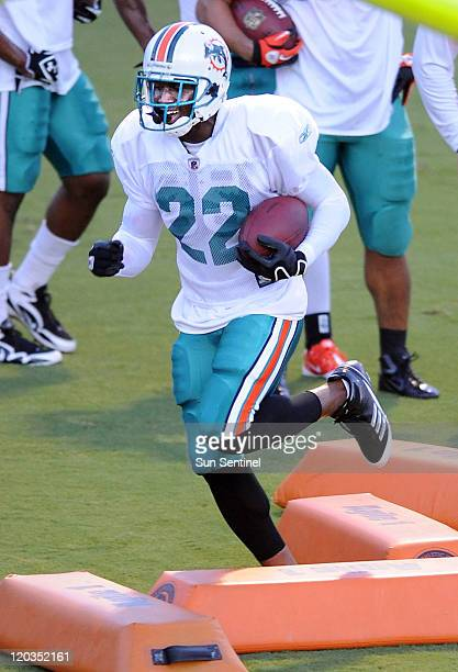 Running back Reggie Bush runs drills during the Miami Dolphins' training camp on Thursday, August 4 at the team's practice facility in Davie, Florida.