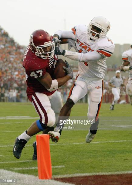 Running back Renaldo Works of the Oklahoma Sooners fights his way into the end zone during the game against the Oklahoma State Cowboys on November 1...