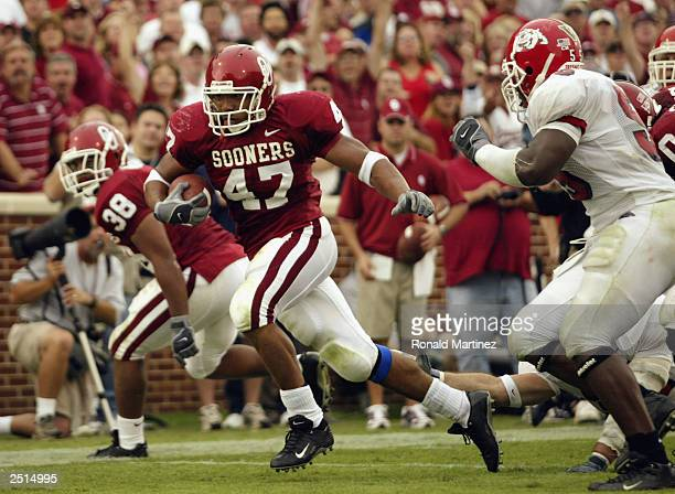 Running back Renaldo Works of the University of Oklahoma Sooners runs for a touchdown against the Fresno State Bulldogs at Gaylord Family...