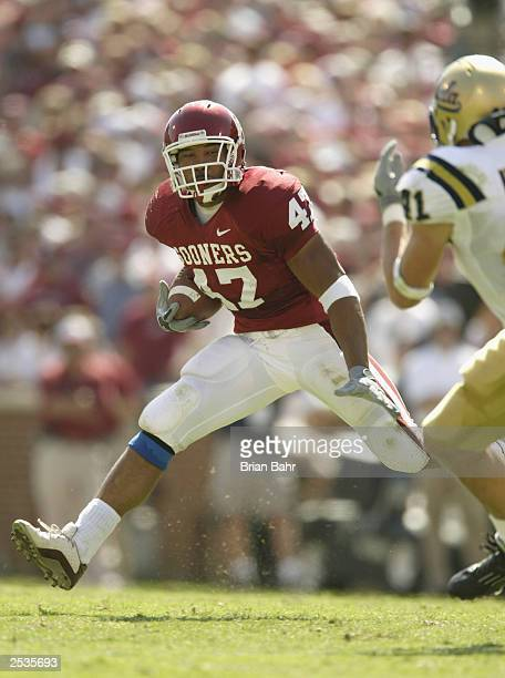 Running back Renaldo Works of the University of Oklahoma Sooners picks up some yardage against the University of California Los Angeles Bruins at...
