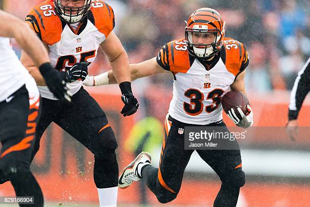 Running back Rex Burkhead of the Cincinnati Bengals runs for a gain during the first half against the Cleveland Browns at FirstEnergy Stadium on...