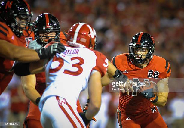Running back Rex Burkhead of the Nebraska Cornhuskers follows his offensive line against linebacker Mike Taylor of the Wisconsin Badgers during their...