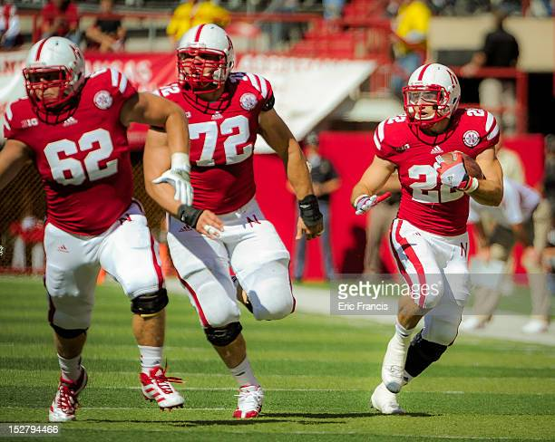 Running back Rex Burkhead of the Nebraska Cornhuskers follows teammate offensive linesman Justin Jackson during their game against the Idaho State...