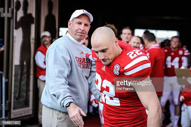 Running back Rex Burkhead of the Nebraska Cornhuskers is congratulated by coach Bo Pelini before their game against the Minnesota Golden Gophers at...