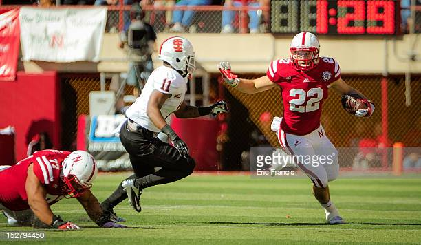 Running back Rex Burkhead of the Nebraska Cornhuskers runs past linebacker Demetrius Allen of the Idaho State Bengals during their game at Memorial...
