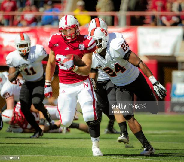 Running back Rex Burkhead of the Nebraska Cornhuskers runs through the Idaho State Bengals defense during their game at Memorial Stadium on September...