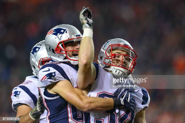 Running back Rex Burkhead of the New England Patriots celebrates a first quarter touchdown against the Denver Broncos at Sports Authority Field at...